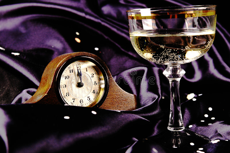 Happy New Year. Clock and champagne royalty free stock photo