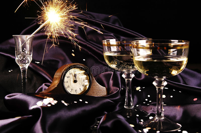 Happy New Year. Clock and champagne