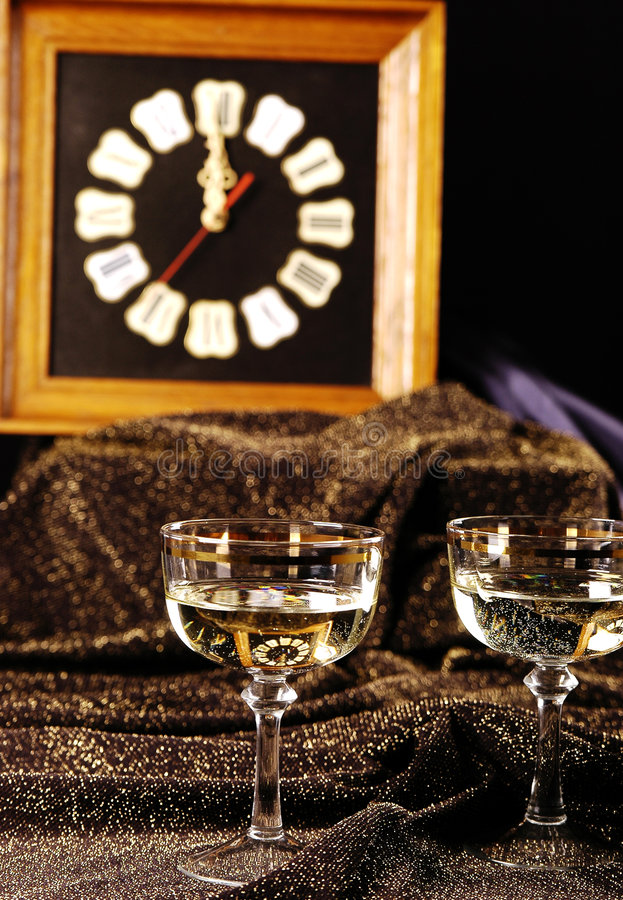 Happy New Year. Clock and champagne stock image
