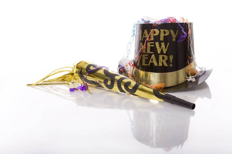 Happy New Year. Party favors including top hat that says Happy New Year and horn isolated against white background royalty free stock photography