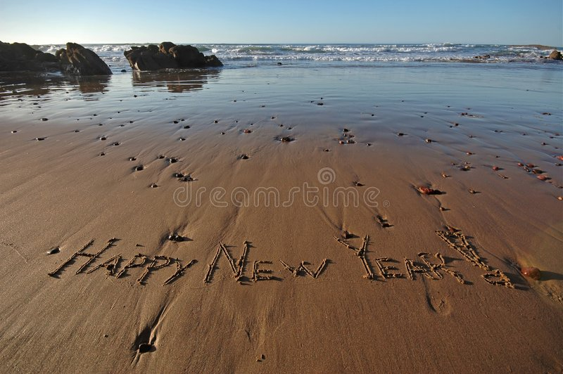 Happy New Year!. Happy New Year message on a beach royalty free stock image