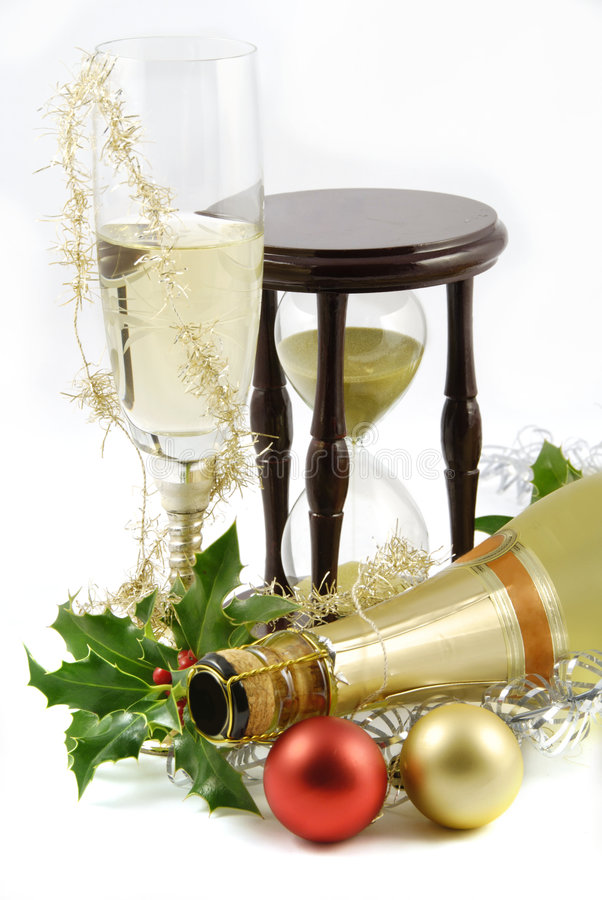 Happy new year. Background with glass of champagne and hourglass stock image
