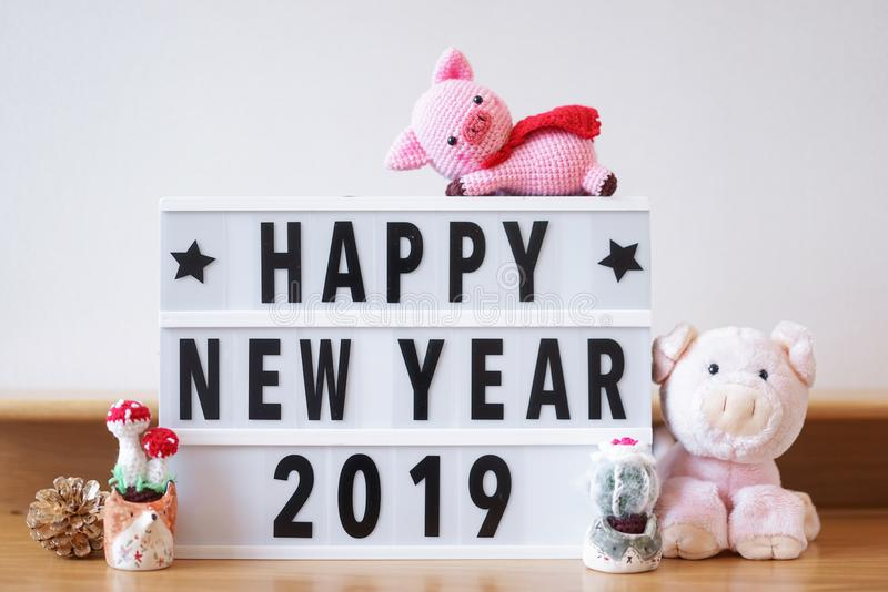 Happy New Year 2019. According to the Chinese animal zodiac, 2019 is a pig year. Copy space on the right to write personal stock image