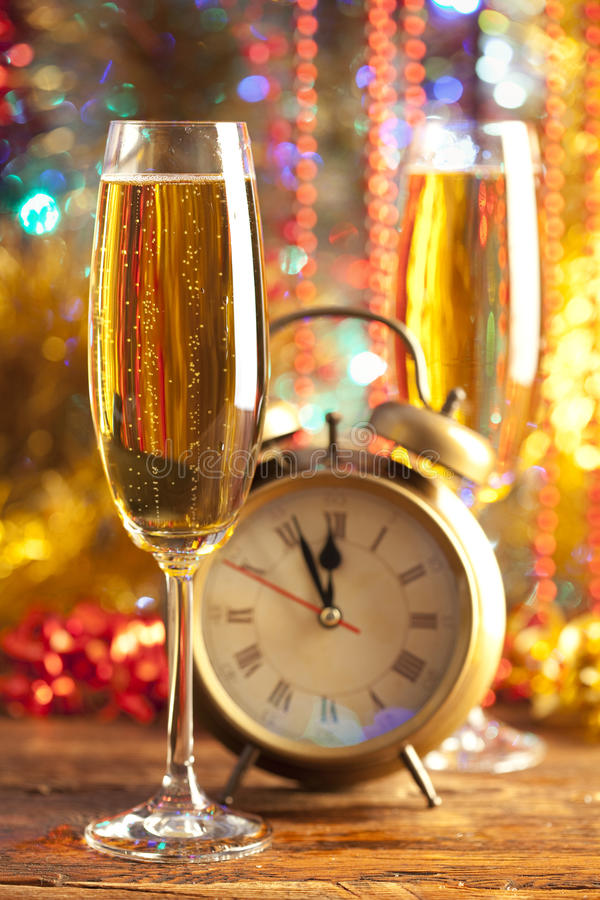 Happy new year. Alarm clock and champagne royalty free stock images