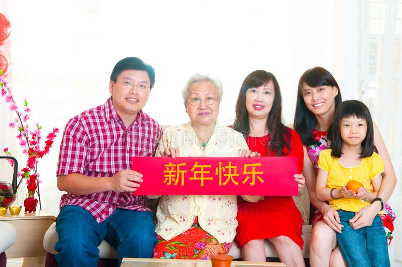 Happy new year. Asian family holding red banner with chinese word `Happy New Year royalty free stock photos