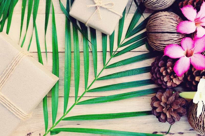 Happy new year background. Eco nature theme. Happy new year background. Wood table decorated with green leaf and pine cone under romantic light tone. Eco nature royalty free stock image
