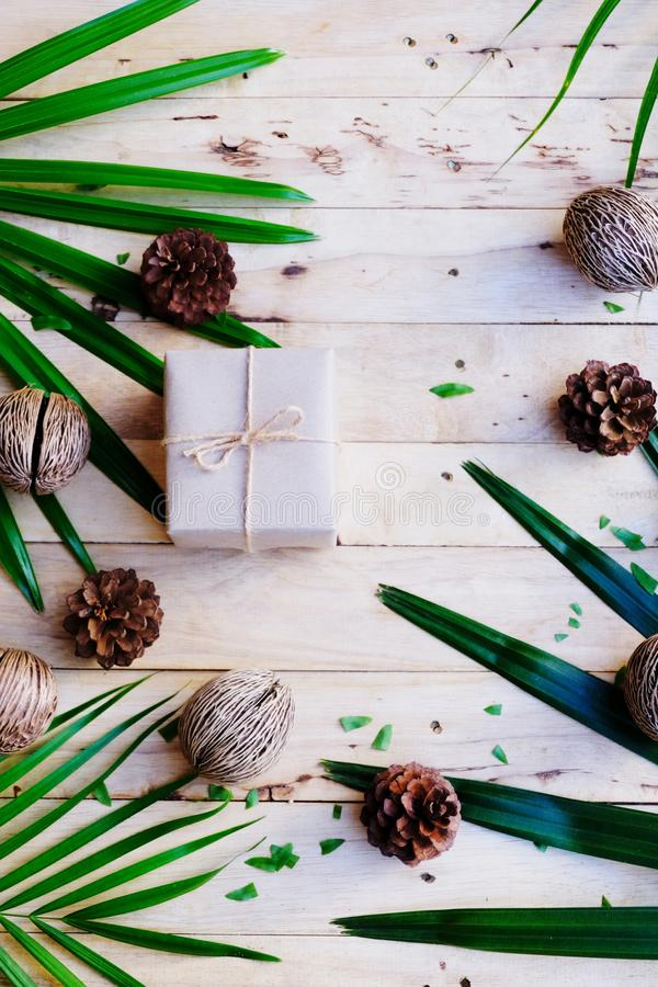 Happy new year background. Eco nature theme. Happy new year background. Wood table decorated with green leaf and pine cone under romantic light tone. Eco nature stock photography