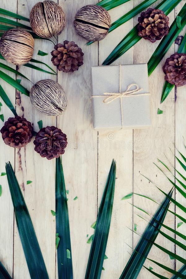 Happy new year background. Eco nature theme. Happy new year background. Wood table decorated with green leaf and pine cone under romantic light tone. Eco nature stock photo