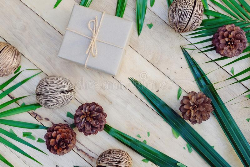 Happy new year background. Eco nature theme. Happy new year background. Wood table decorated with green leaf and pine cone under romantic light tone. Eco nature stock image