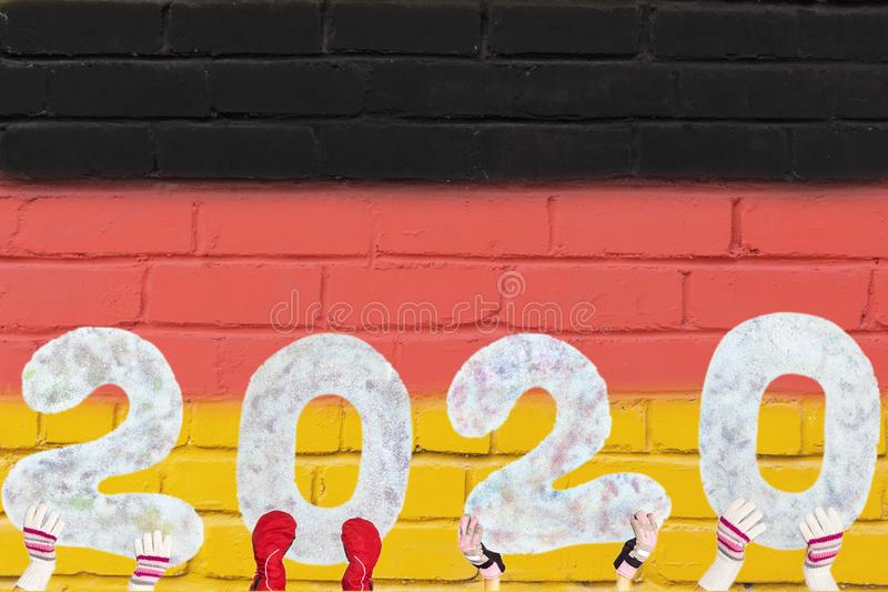 Happy new year 2020 on the background of the flag of Germany with a copy of the space for text, for a holiday card stock photography