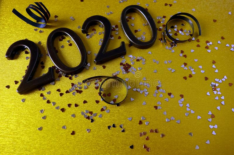 Happy New Year 2020. Background with ornamental digits ribbons and confetti stock photos