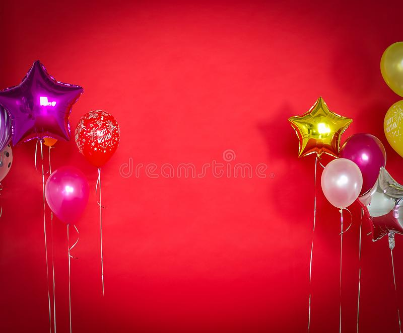 Happy new year, balloons on a red background. With copy space stock images