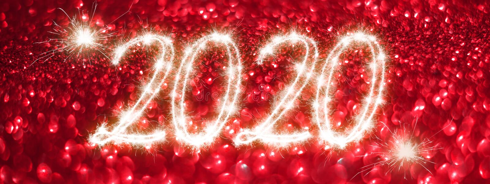 Happy New Year 2020 banner. Number 2020 written sparkling sparklers on red background. Suitable for christmas, new year, chinese stock image