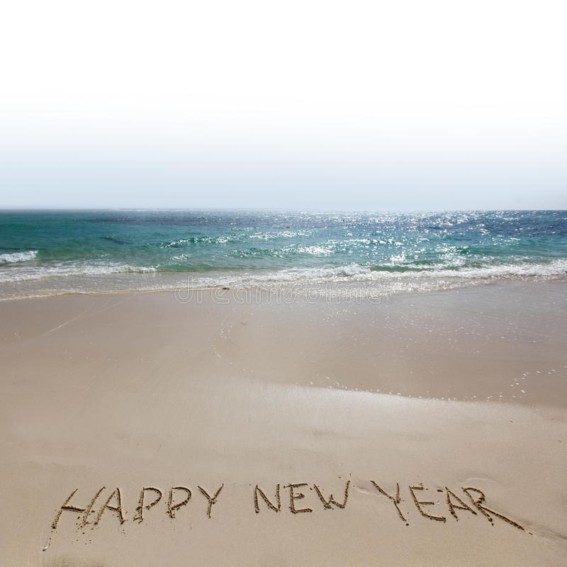 Happy new year on beach. Happy new year handwriting on tropical sea beach stock photography