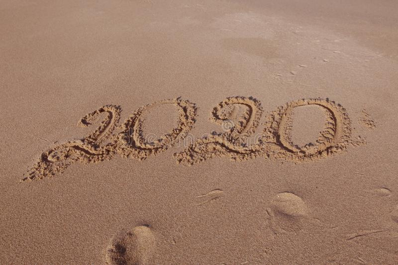 Happy New Year 2020 on beach royalty free stock images
