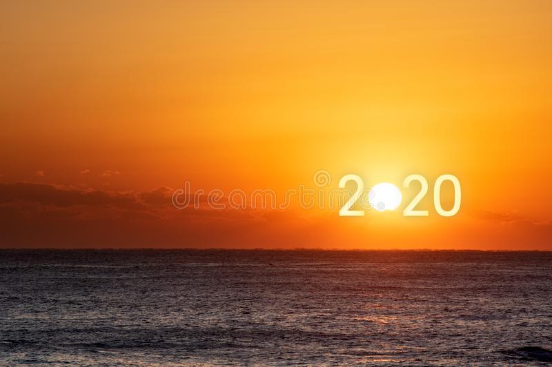 Happy New Year 2020. Beautiful sunrise over the ocean royalty free stock photo