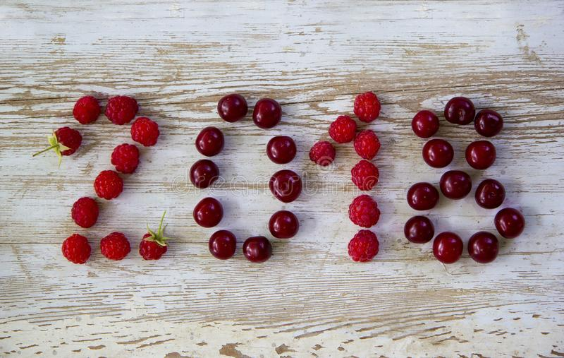 Happy new year 2018 of berries old white wooden background stock photography