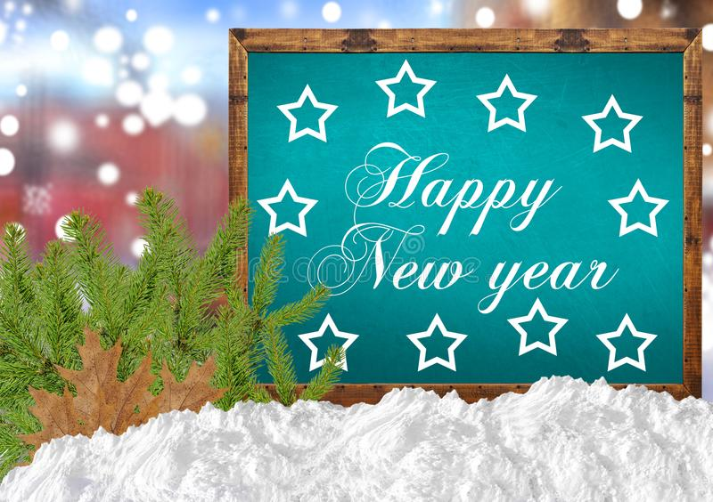 Happy New Year on blue blackboard with blurr city pine and snow. Close royalty free stock images