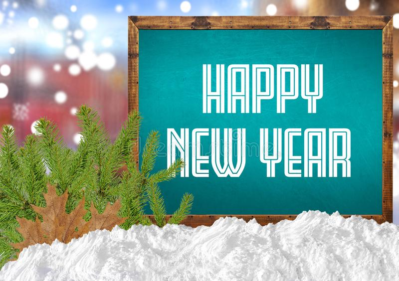Happy New Year on blue blackboard with blurr city pine and snow. Close stock images