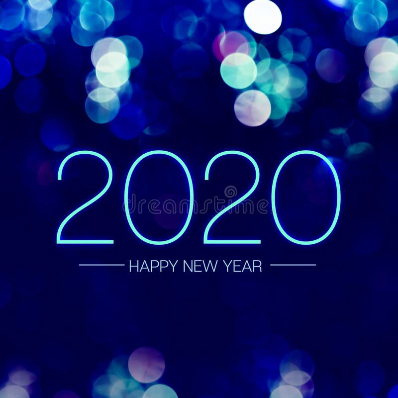 Happy new year 2020 with blue bokeh light sparkling on dark blue purple background,Holiday greeting card stock image