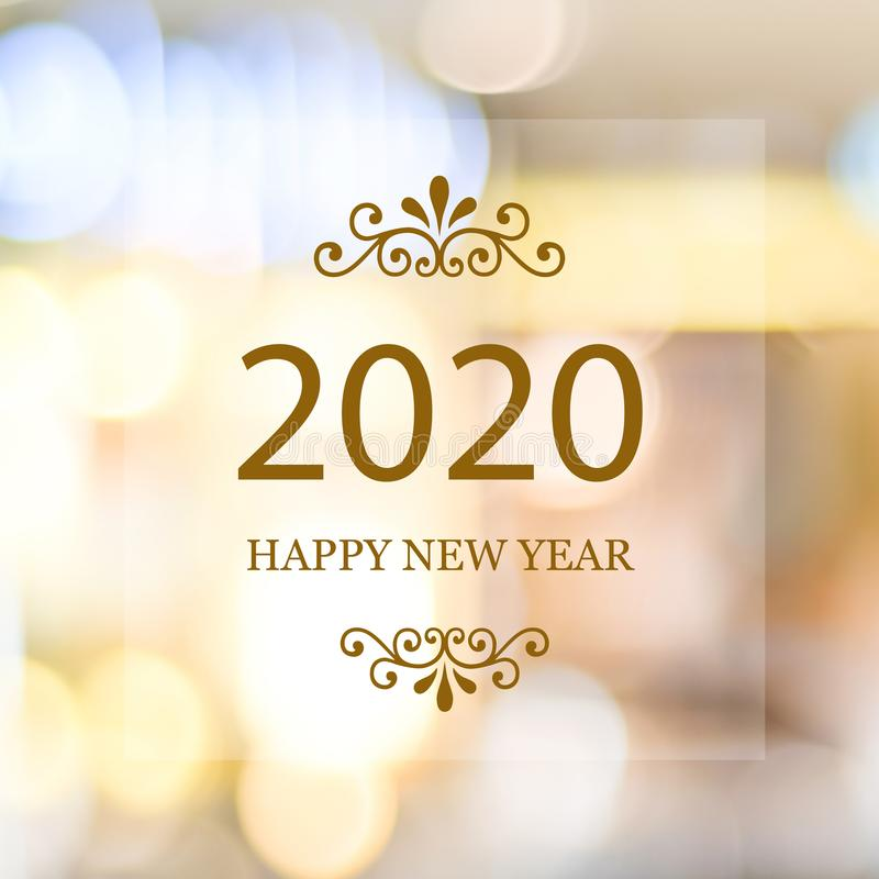 Happy New Year 2020 on blur abstract bokeh background, new year greeting card, banner. Happy New Year 2020 on blur abstract bokeh background, new year greeting royalty free stock photography