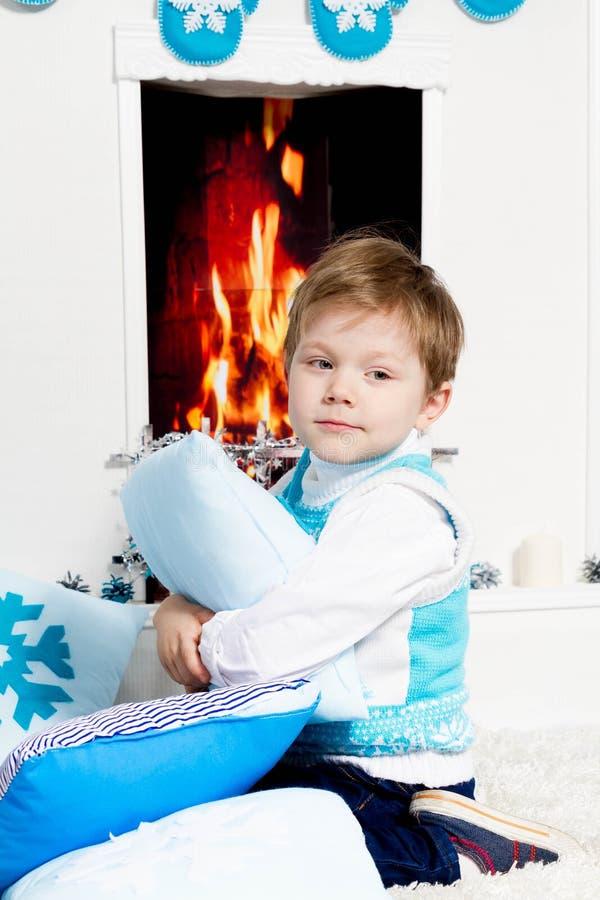 Happy New Year Boy. Fireplace stock image