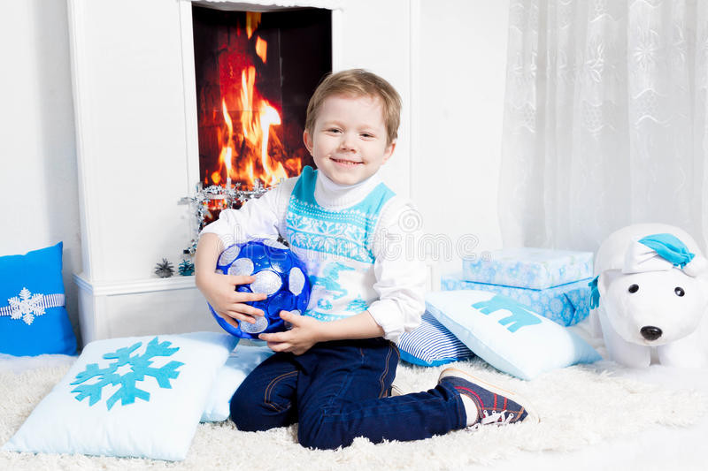 Happy New Year Boy. Fireplace royalty free stock image