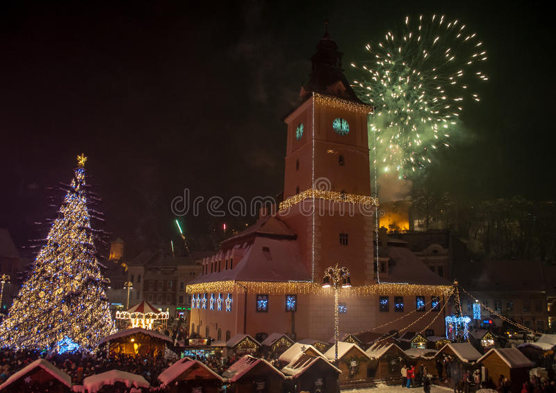 New Year celebration, Piata Sfatului, Brasov. New Year celebration in Piata Sfatului, Brasov with fireworks and Christmas tree stock images