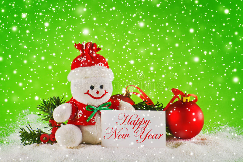 Happy New year. Card. Christmas balls and wool snowman as New Years Eve decor stock image