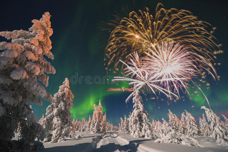 Happy New Year card with firework, forest and northern light. Winter stock photography