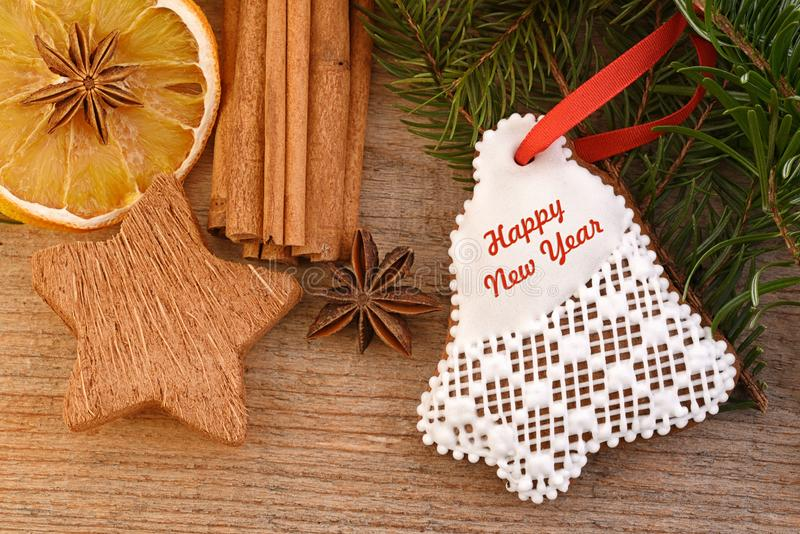 Happy New Year card. Happy New Year card, with gingerbread and spice on wooden table stock photos