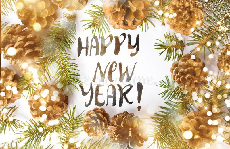 Happy New Year card with pine cones royalty free stock photo