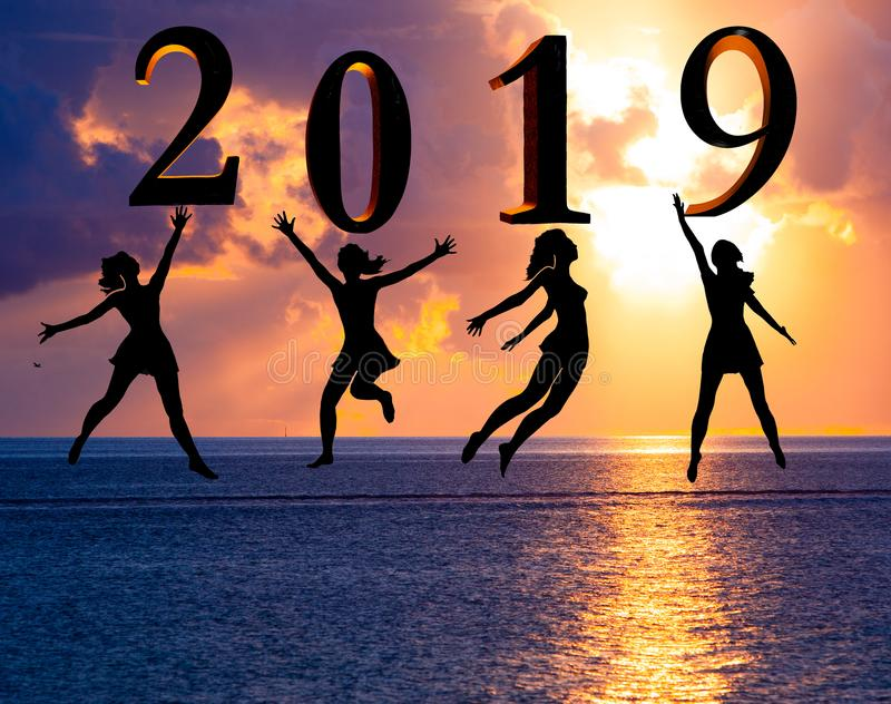 Happy new year card 2019. Silhouette young woman jumping on tropical beach over the sea and 2019 number with sunset background royalty free stock photos