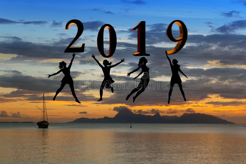 Happy new year card 2019. Silhouette young woman jumping on tropical beach over the sea and 2019 number with sunset background stock photos