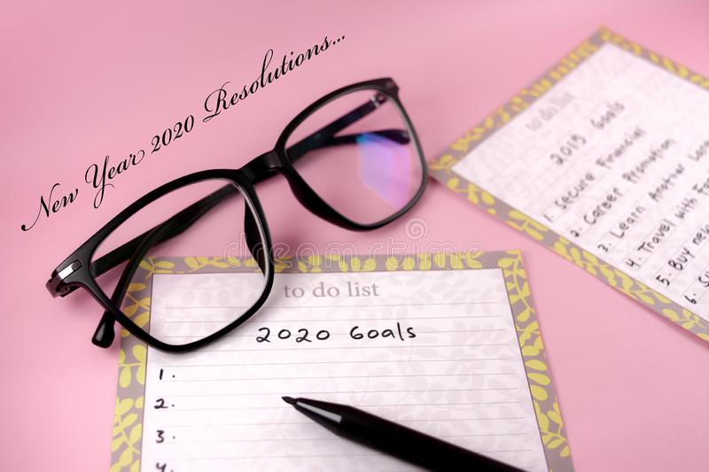 Happy new Year 2020 card and template with text on pink background. Happy new Year 2020 card template with text and planning concept on pink background royalty free stock photo