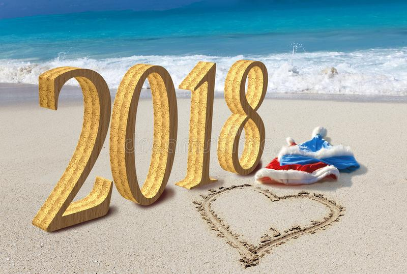 Happy new year card. Two New Year`s caps of Santa Claus on beach and on sand heart is drawn and inscription 2018 royalty free stock image