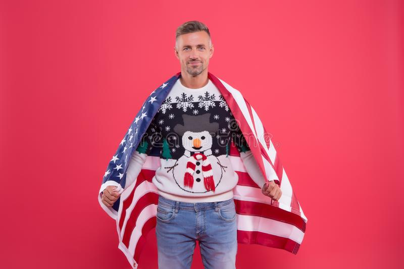Happy new year. celebrating christmas in usa. international holiday. man with american flag. back home on holidays royalty free stock photo