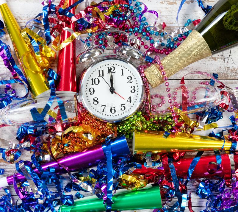 Happy New Year Celebration with clock in center of party objects stock photo