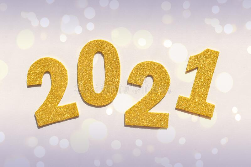 Happy New year 2021 celebration. Gold numeral 2021 and toy car. Pink and yellow colors royalty free stock photography