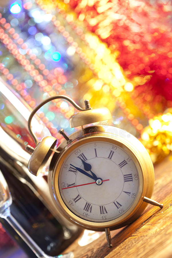 Happy new year - champagne and clock stock photos