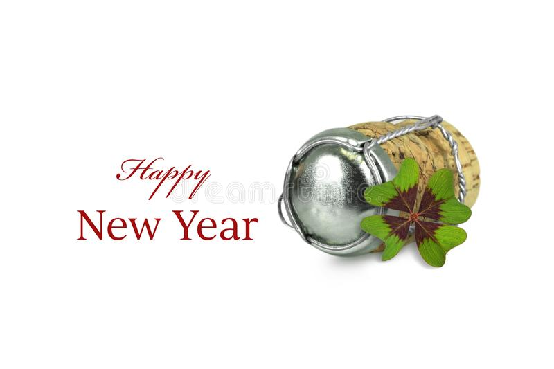 Happy New Year. Champagne cork and shamrock isolated on white royalty free stock photo