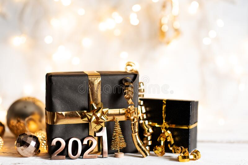Happy new year 2021 with champagne over stone background.  stock photo