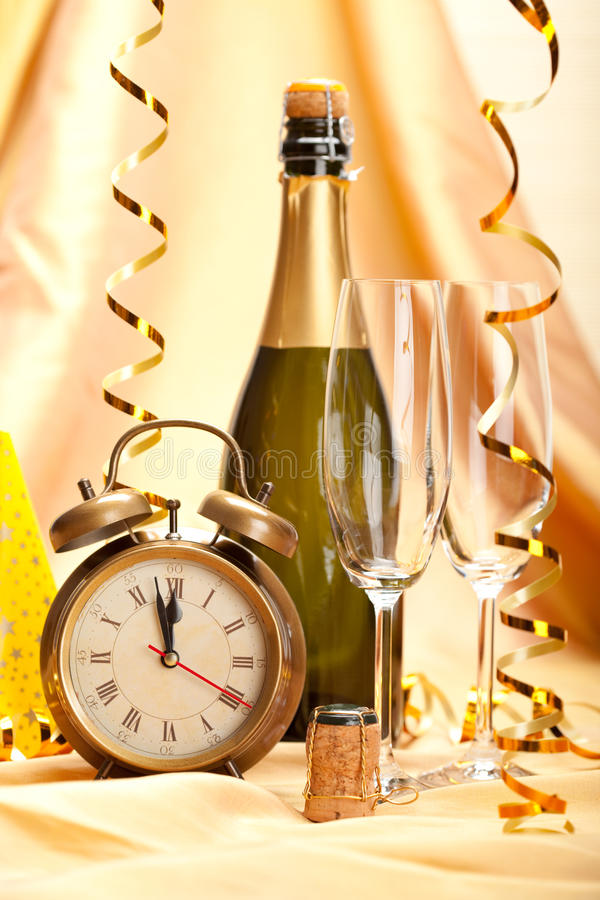 Happy new year - champagne and party decoration royalty free stock images