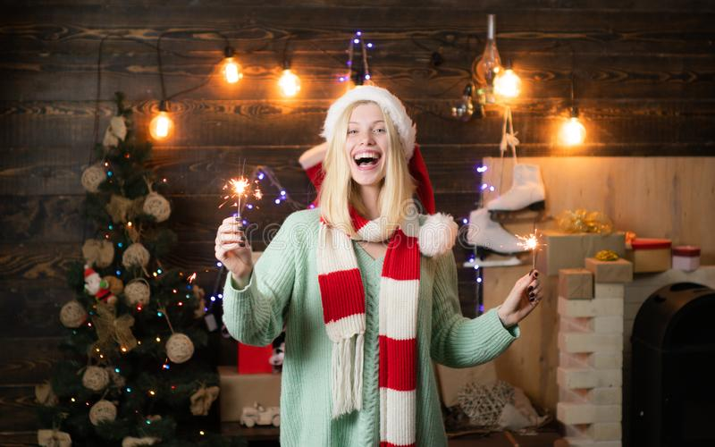 Happy new year. Cheerful woman in santa claus hat. Christmas shopping. New year new goals. royalty free stock images