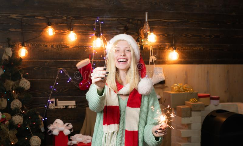 Happy new year. Cheerful woman in santa claus hat. Party fire garland. Winter season holiday. Merry Christmas and Happy royalty free stock images