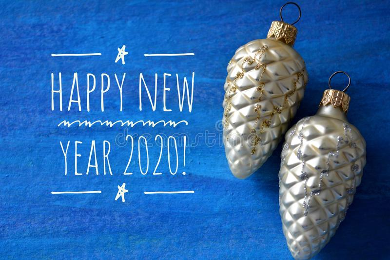 Happy New Year 2020 and Christmas decorations on a blue background royalty free stock images