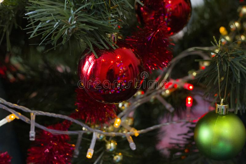 New Year 2020. Christmas decorations on a dark background with lights. Background for design stock image
