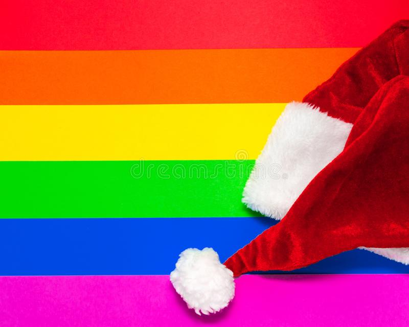 Happy New Year 2020. Christmas hat on LGBT rainbow flag background. Holiday party concept. Postcard mockup for greetings royalty free stock photo