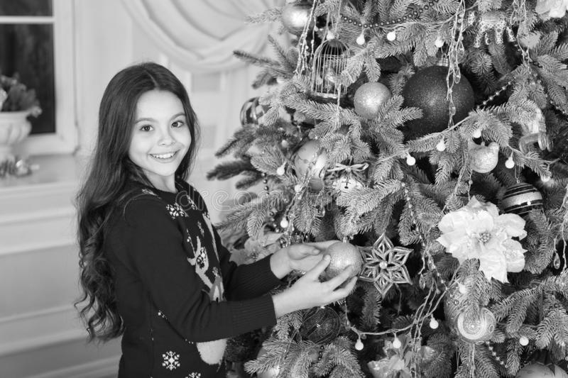 Happy new year. Christmas. Kid enjoy the holiday. small happy girl at christmas. decorate christmas tree. The morning. Before Xmas. New year holiday. little stock photos