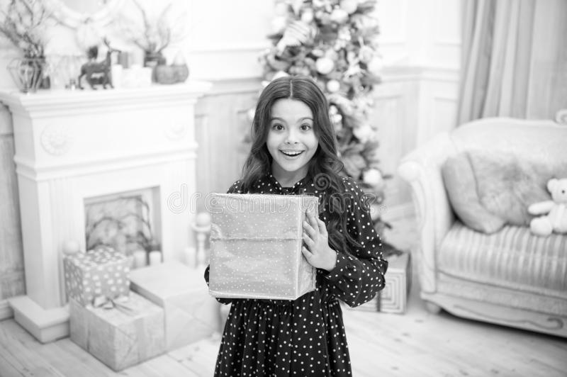 Happy new year. Christmas. Kid enjoy the holiday. small happy girl at christmas. The morning before Xmas. New year. Holiday. little child girl likes xmas stock image